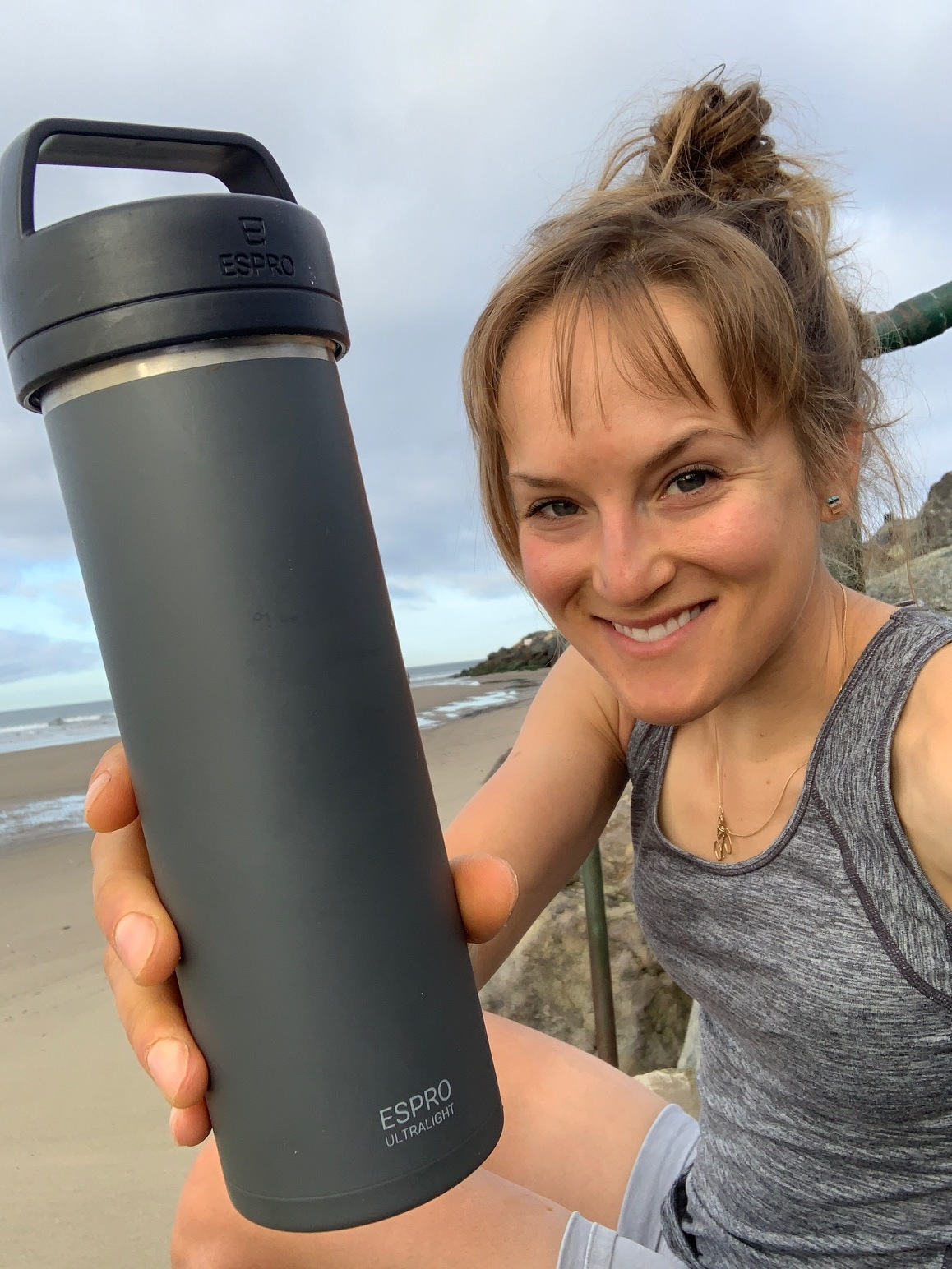 Lex Albrecht on the California beach girl with ESPRO Ultralight frenchpress travel mug